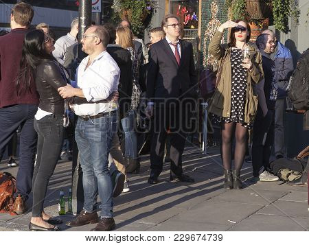 London, England - July 12, 2016 A Crowd Of Young People Talking To Each Other Around A Beer Pub