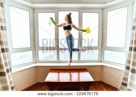 Woman Washing Windows During A Dance, She Does Homework At Home.