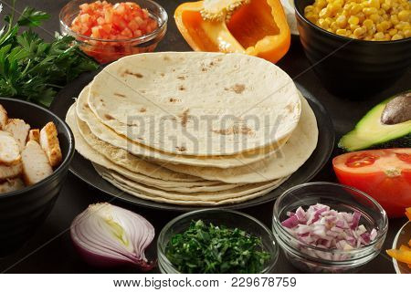 Ingredients For Mexican Wrap Snacks: Pita, Vegetales, Chicken Meat On The Table. Ingredients For Coo