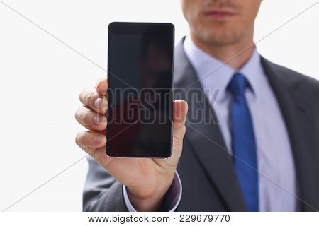 A Businessman Holding Smartphone In Hand Demonstrates Display On Which Calculator Is Depicted With F