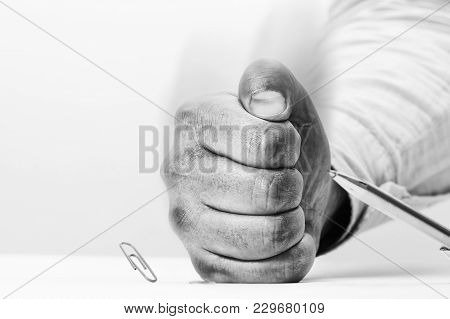 Angry Man Hits The Table With His Fist. Stationery Items On The Table Bounce From His Impact. Concep