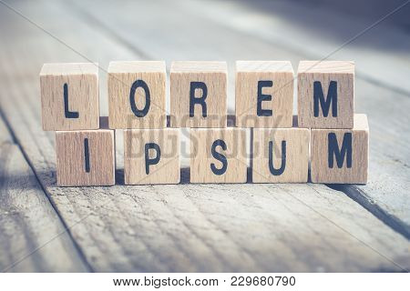 Macro Of The Words Lorem Ipsum Formed By Wooden Blocks On A Wooden Floor