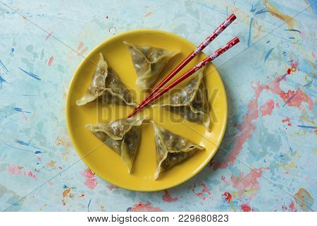 Delicious Oriental Dim Sum Dumplings With Chopsticks