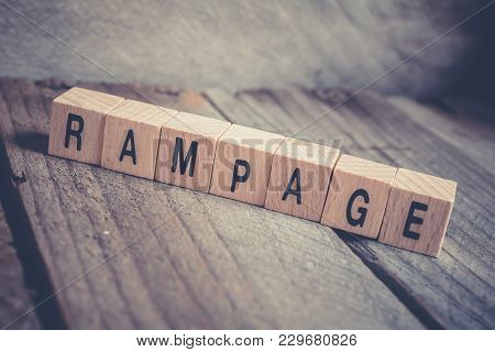 Macro Of The Word Rampage Formed By Wooden Blocks On A Wooden Floor