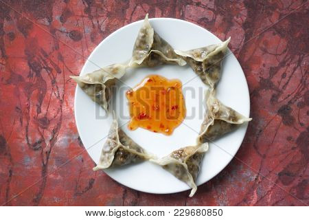 Delicious Oriental Dim Sum Dumplings With Chilli Sauce