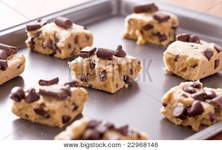 uncooked cookie dough on a baking pan