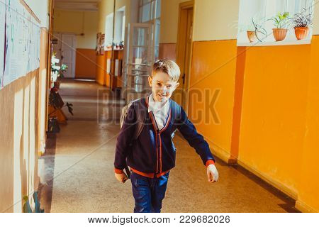 Schoolboy Go Out Of The Classroom On Summer Vacation