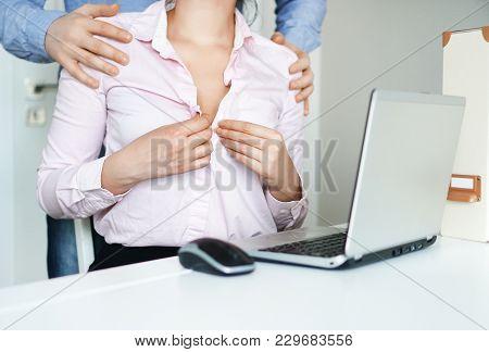 Sexual Flirt At Work. Secretary's Unbuttons Her Blouse.