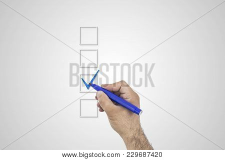 Blank Checklist On Whiteboard With Businessman Hand Drawing A Blue Check Mark In One Checkbox