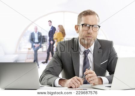 Businessman Working On Laptops At The Office