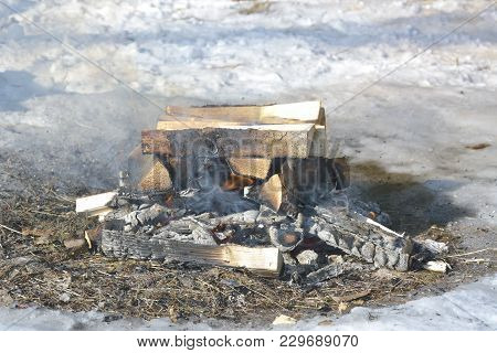 Close Up Of Camping Fire. Camp Fire Photo With Shallow Depth Of Field.