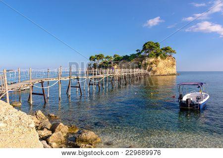 Zakynthos, Greece - October 1, 2017: Wooden Bridge From Agios Sostis Leading To Small Rocky Island.