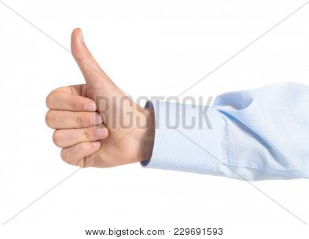 Close-up Of A Hand Showing Thumb Up Sign Over White Background