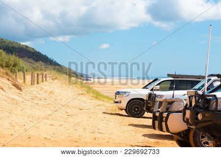 4Wd Vehicles At Rainbow Beach With Coloured Sand Dunes, Qld, Australia
