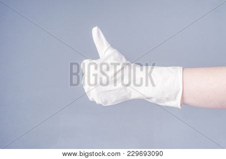 Doctor Hand With Glove Showing Like Gesture Or Thumbup As Approval, Accept Or Done Concept
