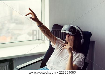 Young Caucasian Woman Playing With A Vr Headset On