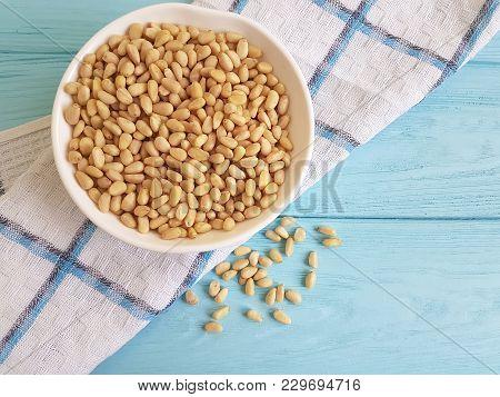 Pine Nuts Blue Wooden Background Dish Towel, Cedar