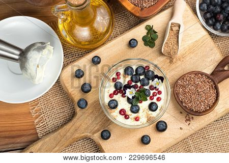 Cottage Cheese Blended With Flax Seed Oil, Topped With Blueberries, Wild Cranberries, Edible Flowers