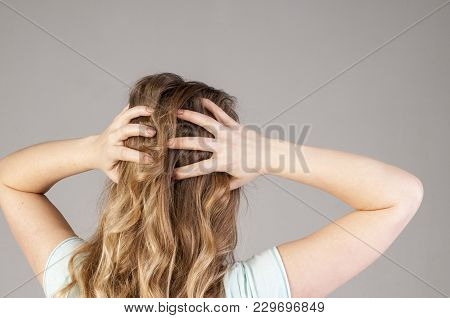 A Young Girl From The Back With A Strong Headache. Convulsive Spasm And Headaches Concept.
