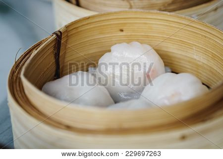 Traditional Cantonese Dumplings Called Har Gow (shrimp Dumpling) In A Bamboo Steamer. These Transluc