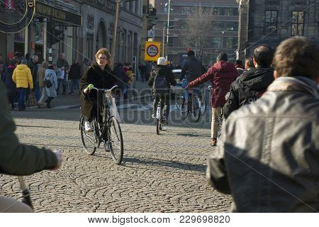 Amsterdam At The Dam Square / The Netherlands - February 24th Very Busy Intersection At The Dam Squa