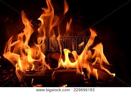 Burning Fire And Smoldering Live Coal Red, Orange And Black Background. Arson. Danger Of A House Fir