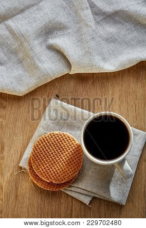 White Porcelain Cup Of Earl Grey Or Black Tea With Wafflesdecorated With Light Cotton Napkin On A Ru