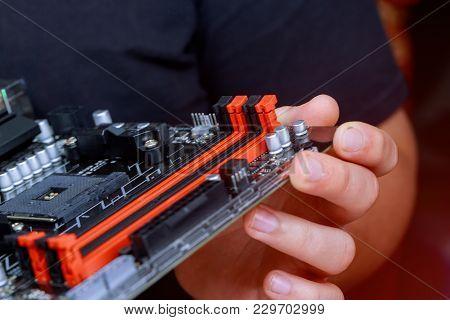 The Engineer Installing Memory Ram On Motherboard Computer In Computer Lab. Installing Computer Ram