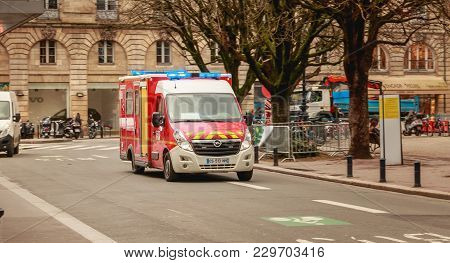 Bordeaux, France - January 26, 2018 : Firefighter Ambulance Driving Fast On A Street In Bordeaux On