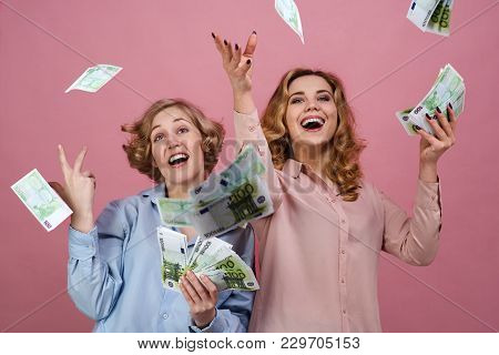 Young Happy Girl With Delight Throw Up The Cash. They Enjoy Success And Prosperity, Financial Market