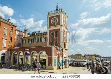 Rovinj, Croatia, September 27, 2017: Tourists Visit The Famous  Clock Tower In Rovinj , Eating And R