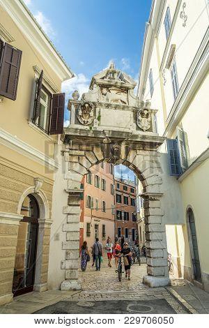 Rovinj, Croatia, September 27, 2017: Tourists Visit The Famous Entrance Gate In Rovinj Leading To Th