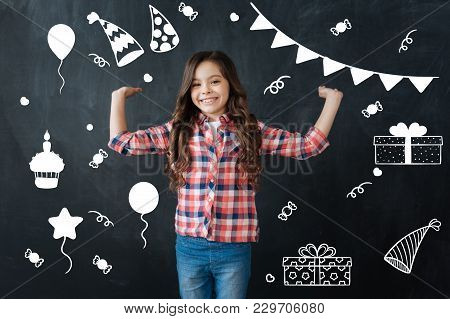 Birthday Party. Cheerful Little Emotional Girl Feeling Happy And Standing With Her Hands Up While Wa