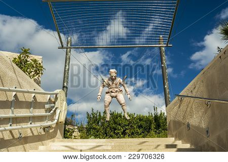 Prvic, Croatia - September 29, 2017: Monument Of The  First Parachute Builder At The Museum Entrance
