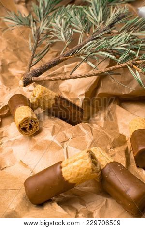 Sweet Wafer With Dark Chocolate On The Paper Bag With Green Tree