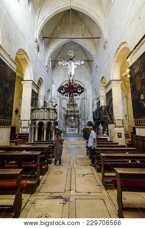 Trogir, Croatia, October 01. 2017: Tourists And Believer Inside The Saint Lawrence Cathedral In Trog