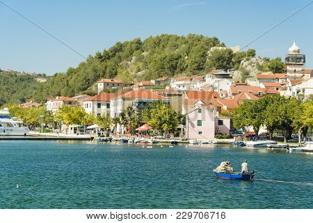 Skradin, Croatia, September 28, 2017: Fischer And Tourist In The Beautiful Town Of Skradin