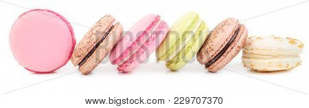 A French Sweet Delicacy, Macaroons In Row. Isolated On White Background.