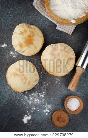 Homemade Whole Pita - Baked Israeli Flat Bread. Pita With Flour On A Concrete Background