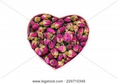 Dried Rose Buds For Tea In The Shape Of A Heart. Chinese Tea From Yunnan. Bi Lo Chun. Copy Space. Is