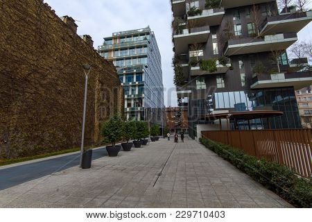 Modern Street Under The Buildings In The Vertical Forest In The Milano District.