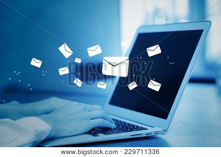 Closeup Hand Of Businesswoman Using A Computer Keyboard Of Sending Email On Blue Tone, Communication