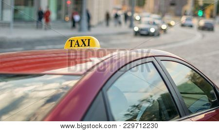Taxi To The Center Of The City On A Busy Street With Heavy Traffic Parked On The Sidewalk Of The Roa