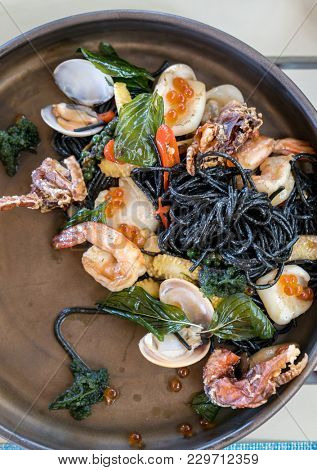 The Mediterranean delicacy food. Black seafood pasta spaghetti  with mussels calm shrimp and crab