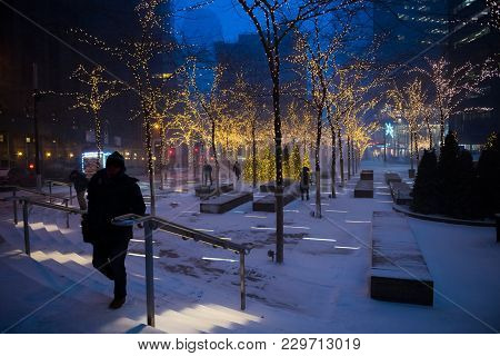 New York-january 4: Early Morning Commuters Passing Through Zucotti Park During The Holiday Season O