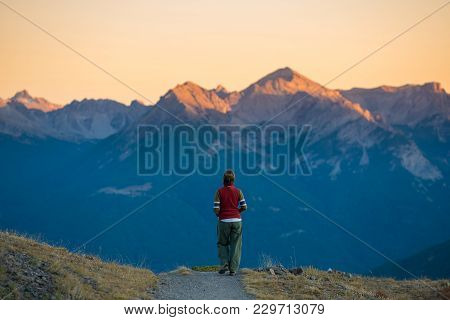 Backpacker Walking On Hiking Trail In The Mountain. Summer Adventures Summer Vacation On The Alps. W