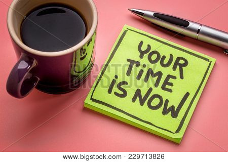 Your time is now reminder note with a cup of coffee