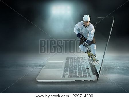 Caucassian ice hockey Players in dynamic action in a professional sport game play on the laptop in hockey under stadium lights.