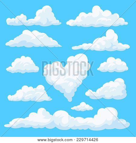Set Of Clouds Isolated On Blue Background. Fluffy Clouds In The Cartoon Style. Daytime Sky. Vector I