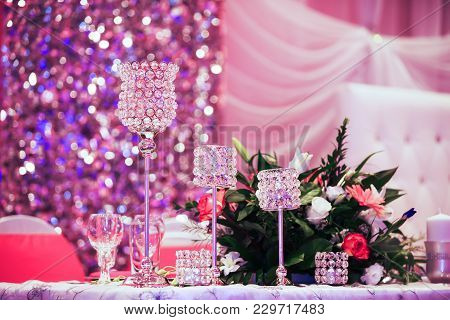 Beautiful Glasses On Banquet Table. Decoration Glasses For The Wedding Ceremony On The Table Against